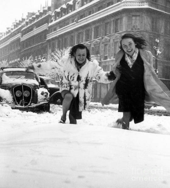 Wintry Photograph - Young Woman Running In The Snow In Paris, 1946  by French School