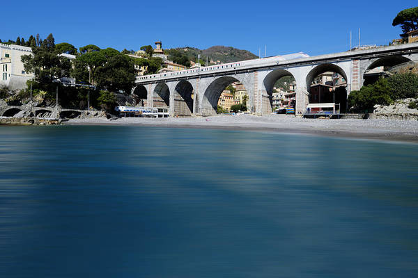 Photograph - Zoagli Smooth Waves Beach With Train Bridge by Enrico Pelos
