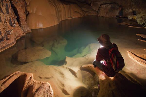 Stalagmite Photograph - A Filipino Tour Guide Holds A Lantern by Sean White / Design Pics