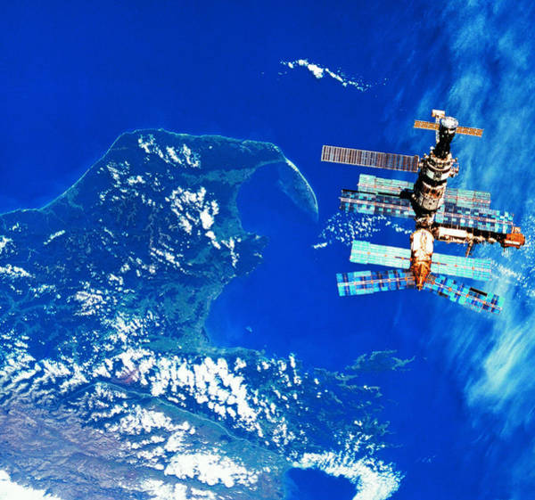 Wall Art - Photograph - A Space Station Orbiting Above Earth by Stockbyte