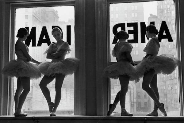 Photograph - Ballerinas Standing On Window Sill In by Alfred Eisenstaedt