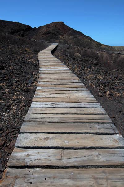 Wall Art - Photograph - Boarded Footpath Through Black Lava Field Punta De Teno Tenerife Spain by imageBROKER - Michael Weber