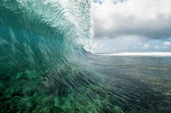 Rarotonga Photograph - Breaking Wave Over A Coral Reef by Thomas Pickard