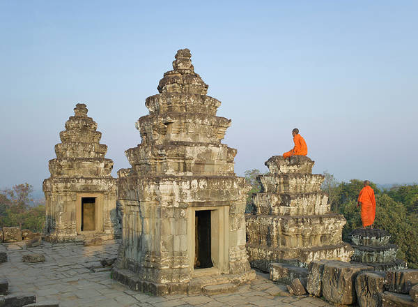 Reap Photograph - Buddhist Monks Amongst Temple Ruins by Martin Puddy