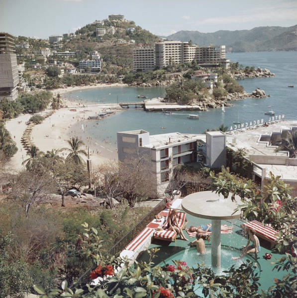 Vertical Landscape Photograph - Caleta Beach, Acapulco by Slim Aarons