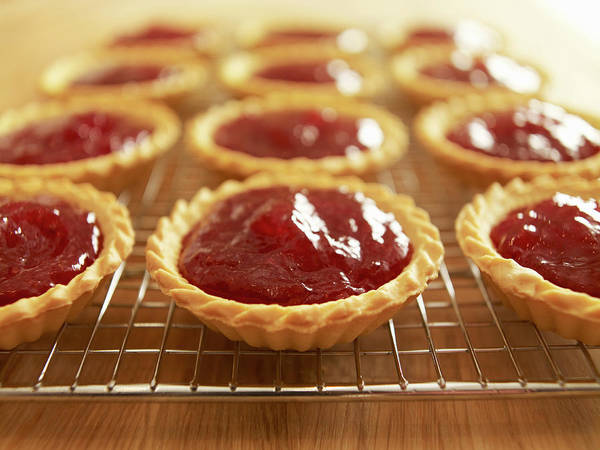 Items Photograph - Close Up Of Jam Tarts Cooling On Wire by Adam Gault