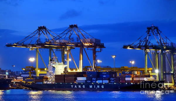 Photograph - Containers Are Loaded Onto Ships In  Kaohsiung Harbor by Yali Shi