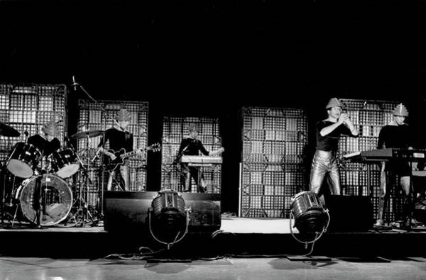 New Wave Music Photograph - Devo Performing by Michael Ochs Archives