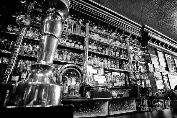 Wall Art - Photograph - draft beer pumps in The Long Hall victorian pub one of the oldest pubs in Dublin republic of Ireland by Joe Fox