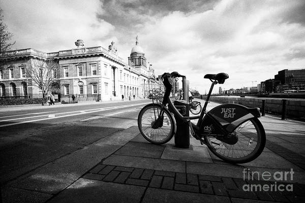 Wall Art - Photograph - dublin bikes public bike hire rental scheme near the custom house Dublin Republic of Ireland europe by Joe Fox