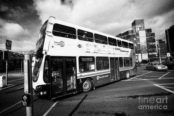 Wall Art - Photograph - dublinbus double deck volvo wrightbus eclipse gemini bus turning at custom house quay Dublin Republi by Joe Fox