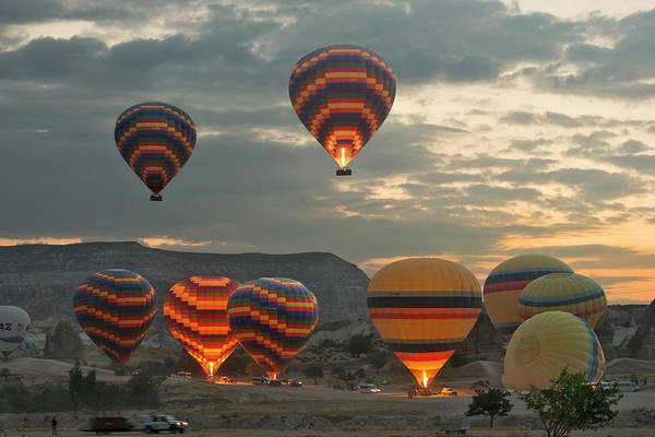 Nevsehir Photograph - Early Morning Hot Air Balloons In by Izzet Keribar