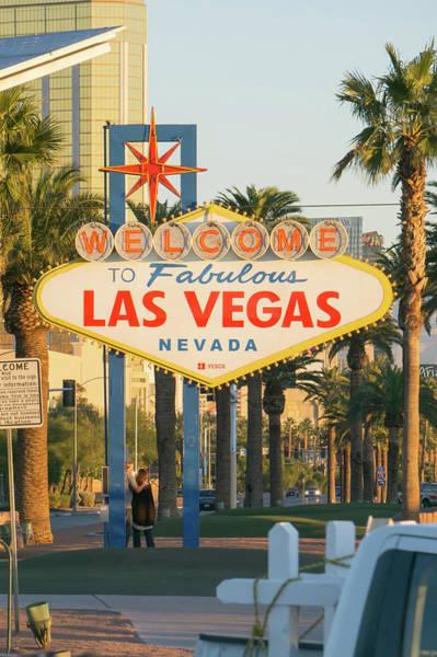 Photograph - Early Morning Sun Illuminating Las Vegas Sign And Vegas Skyline  by Alex Grichenko