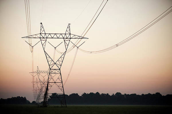 Electricity Generation Photograph - Electrical Power Lines Against The by Wesley Hitt