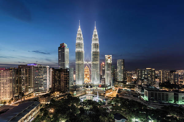 Public Places Wall Art - Photograph - Elevated View Of The Petronas Towers At by Martin Puddy