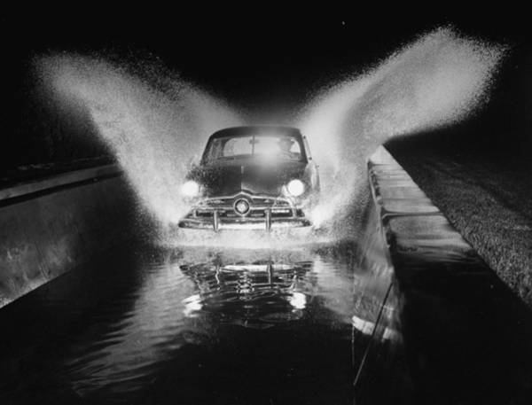 Photograph - Ford Car Being Driven Through Deep Water by Gjon Mili
