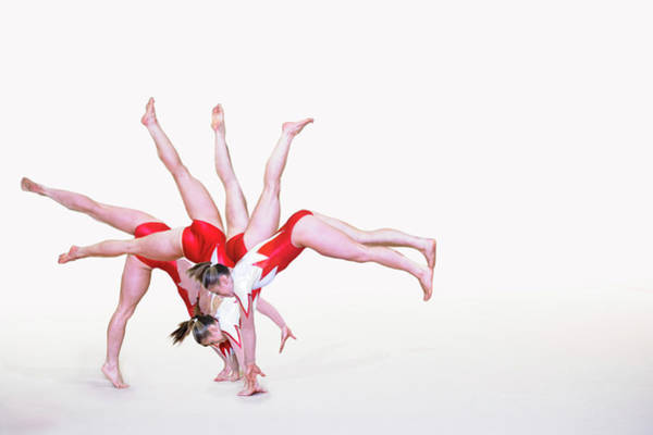 Coordination Wall Art - Photograph - Gymnast Performing by Gustoimages