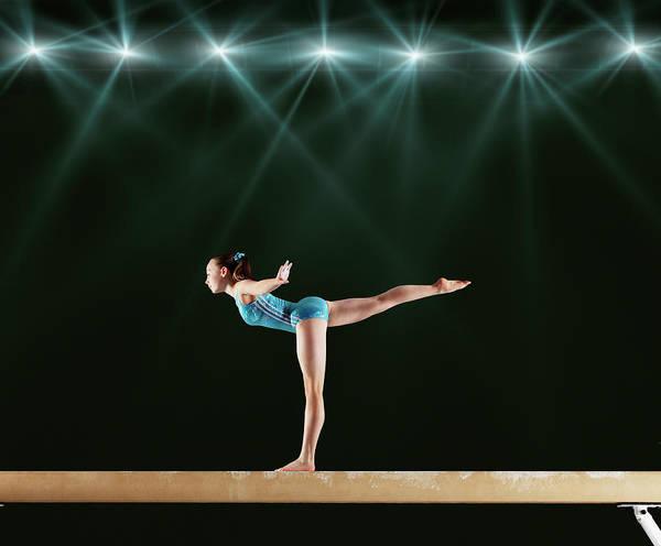 Determination Photograph - Gymnast Performing Routine On Balance by Robert Decelis Ltd