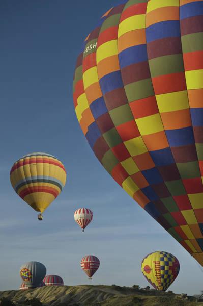 Cappadocia Photograph - Hot-air Ballooning In Cappadocia by Izzet Keribar