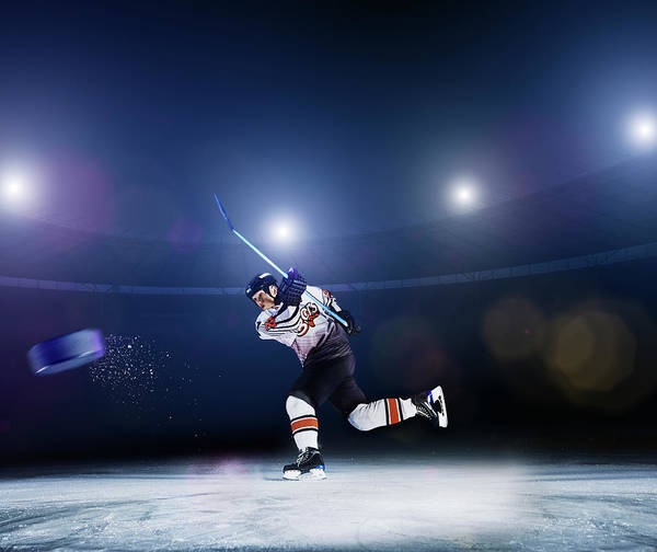 Ice Hockey Photograph - Ice Hockey Player Shooting Puck by Robert Decelis Ltd
