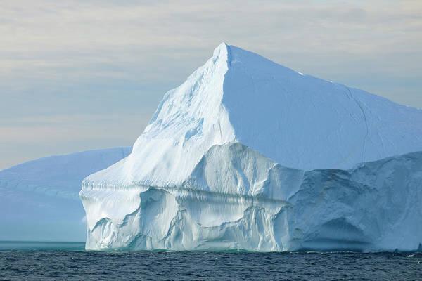 Bleached Photograph - Iceberg In Scoresbysund, Greenland by Raimund Linke
