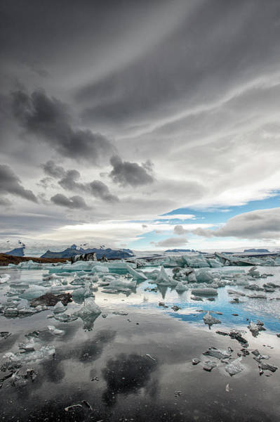 Storm Photograph - Icebergs In Glacial Lagoon With Stormy by Mike Hill