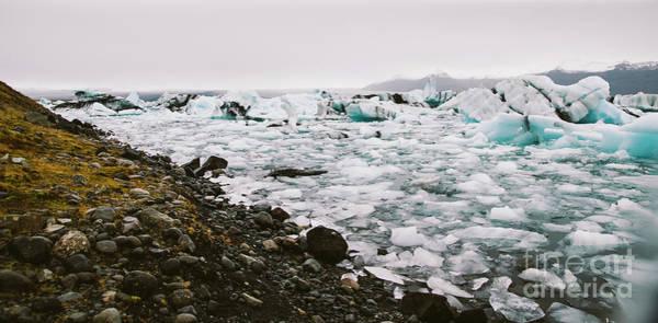 Photograph - Large Blocks Of Broken Ice From An Icelandic Glacier. by Joaquin Corbalan