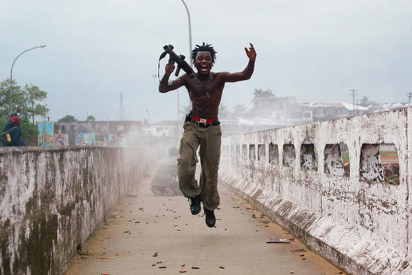 Jumping Photograph - Liberian Government Troops Push Back by Chris Hondros