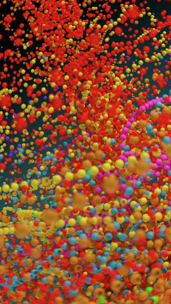 Wall Art - Photograph - Lots Of Multi Colored Bouncing Beads by Ikon Images