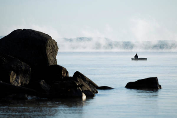 Sport Fishing Photograph - Man Fishing In Canoe On A Misty Lake by Gabe Palacio