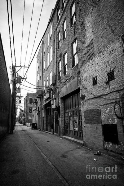 Wall Art - Photograph - narrow alleyway behind stores in the wicker park neighborhood of Chicago IL USA by Joe Fox