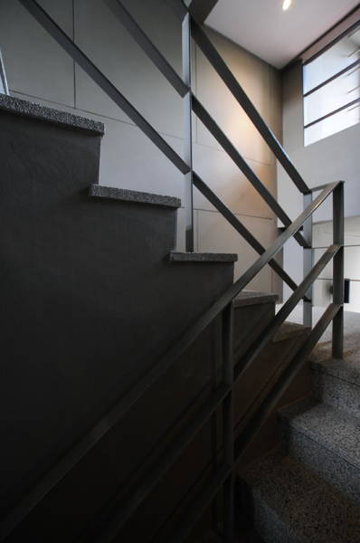 Vertical Perspective Photograph - Open Stairwell In A Modern Building by Primeimages