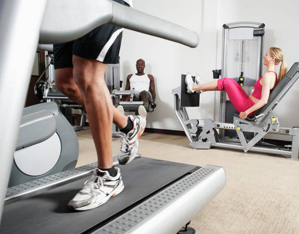 Sports Training Photograph - People Exercising In Health Club by Erik Isakson