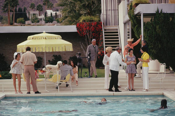 1970 Photograph - Poolside Party by Slim Aarons