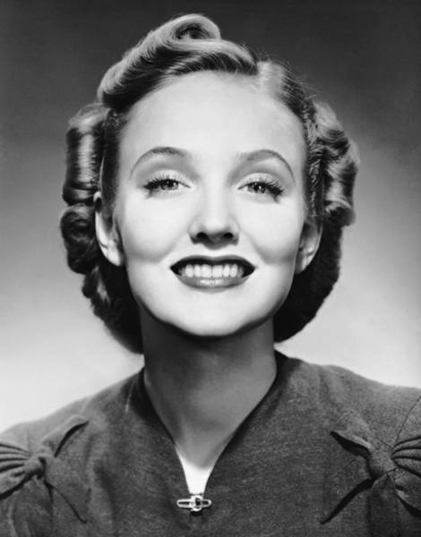 Hairstyle Photograph - Portrait Of Smiling Woman by George Marks