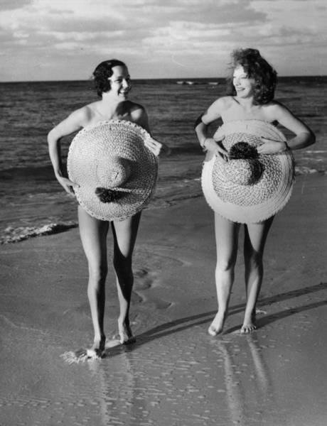 Hiding Photograph - Protective Sunhats by Fox Photos
