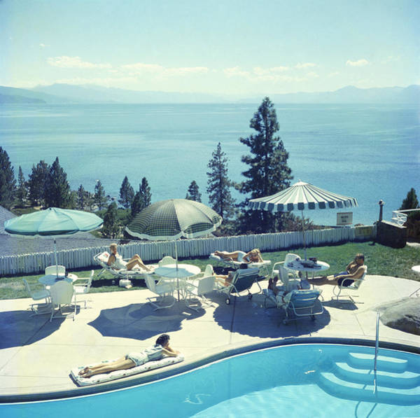 Swimming Pool Photograph - Relaxing At Lake Tahoe by Slim Aarons