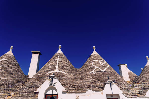 Photograph - Roofs With Symbols In The Trulli, In The Famous Italian City Of Alberobello. by Joaquin Corbalan
