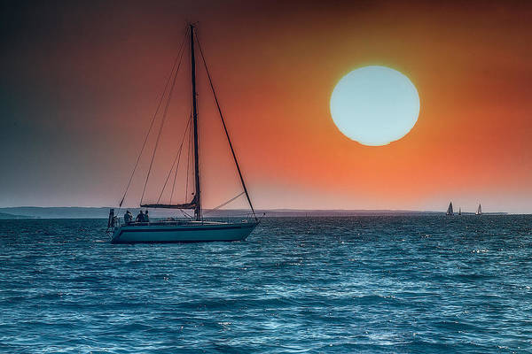 Photograph - Sailing Into The Sunset by Wolfgang Stocker