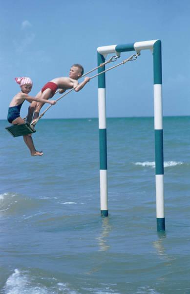 Friendship Photograph - Sea Swing by Slim Aarons