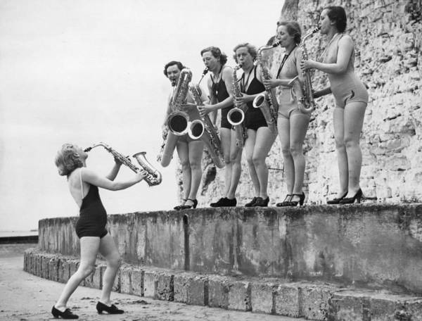 Humor In Art And Photograph - Silver Sax Six by Fox Photos