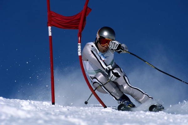 Helmet Photograph - Skier Skiing Around Red Gate by Zoom Agence
