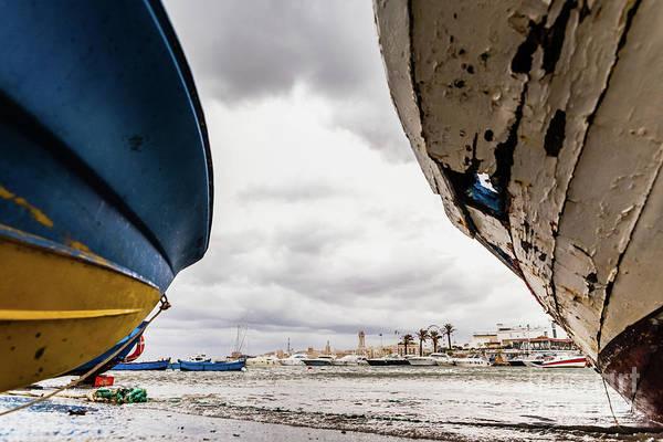 Photograph - Small Boat Moored To Bari Port, Italy, During A Storm At Sea. by Joaquin Corbalan