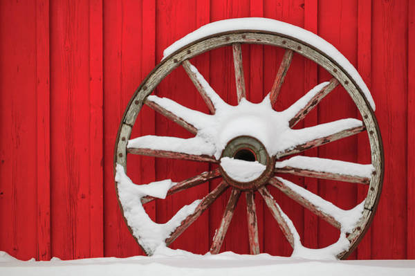 Wagon Wheel Photograph - Snow-covered Wagon Wheels Against Red by Stuart Westmorland