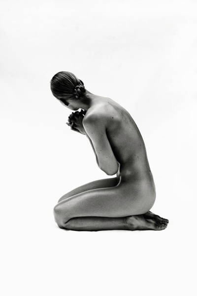 Naked Photograph - Studio Shot Of Naked Woman Sitting by Win-initiative