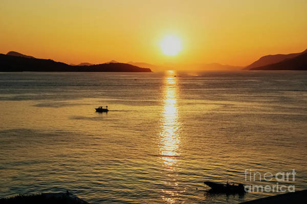 Photograph - Sunset In A Bay With Mountains In The Background And A Small Boa by Joaquin Corbalan