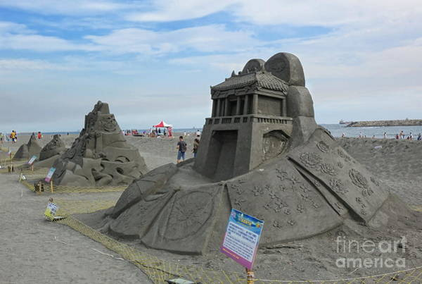 Photograph - The Black Sand Sculpture Festival In Taiwan by Yali Shi