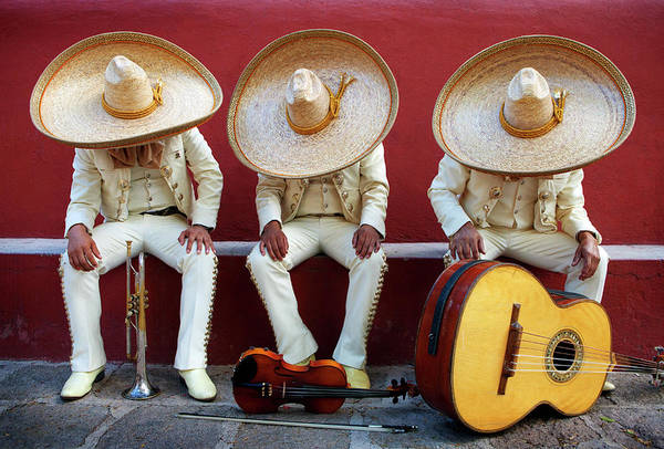 San Miguel De Allende Wall Art - Photograph - Three Mariachis On An Orange Wall by Holly Wilmeth