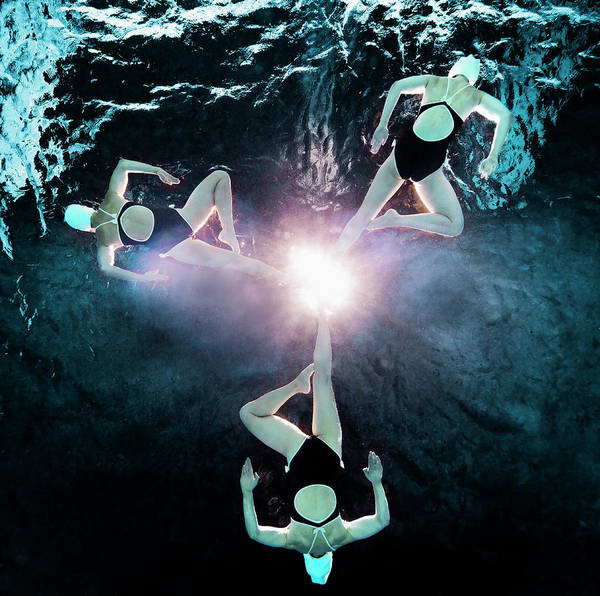 Wall Art - Photograph - Three Synchronised Swimmers In Formation by Henrik Sorensen