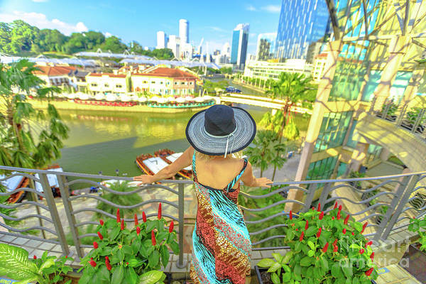 Photograph - Tourist Woman At Clarke Quay by Benny Marty